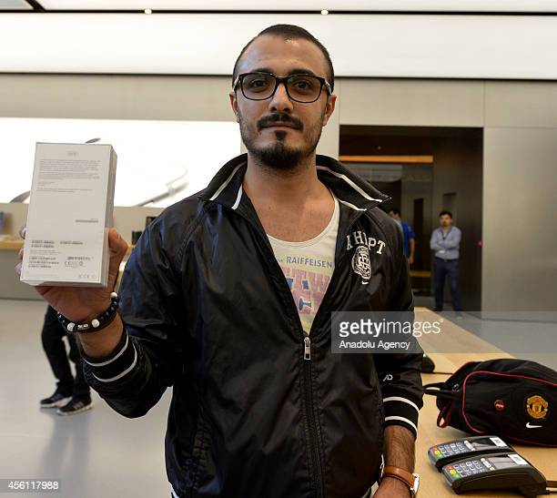 A man comes from Izmir west of Turkey to buy iPhone 6 shows his iPhone 6 as iPhone 6 and iPhone 6 Plus retail sales begin at Apple Store Zorlu Center...
