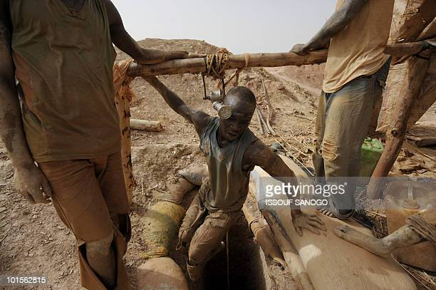 Man comes out of a hole where he is digging for gold in Namisgma,the largest gold washing site in the country, some 200 kilometers from Ouagadougou,...