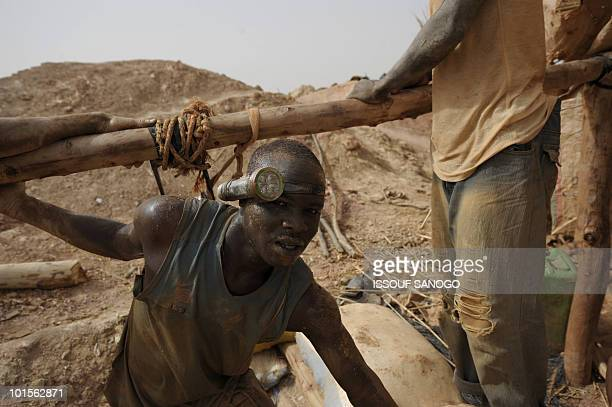 RETRAITE** A man comes out of a hole where he is digging for gold in Namisgmathe largest gold washing site in the country some 200 kilometers from...