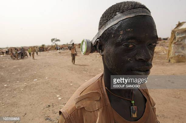 RETRAITE** A man comes out of a hole where he was digging for gold in Namisgmathe largest gold washing site in the country some 200 kilometers from...