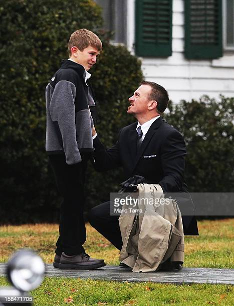 Man comforts a boy outside Honan Funeral Home before the funeral for 6-year-old Jack Pinto on December 17, 2012 in Newtown Connecticut. Pinto was one...