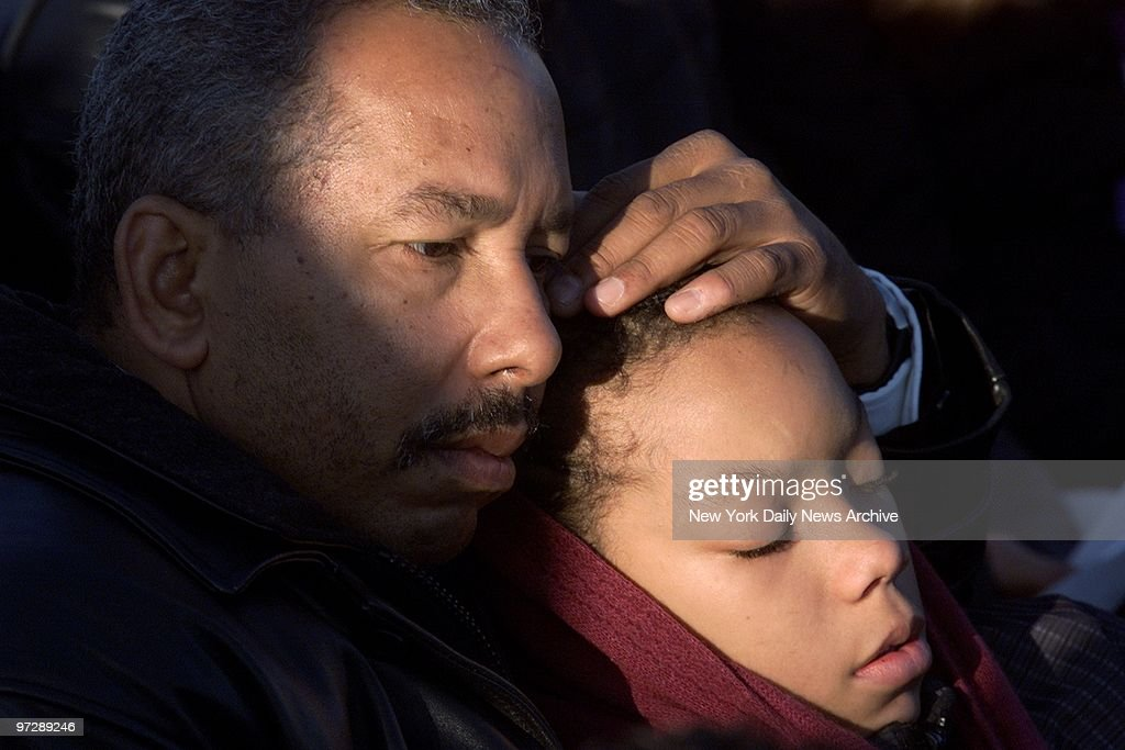 Man comforts a child during a prayer service for victims of  : News Photo