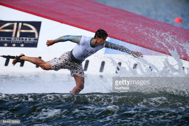 A man competes during the mens tricks final match of the 2017 IWWF World Water Ski Championships on September 10 2017 in ChoisyleRoi near Paris France