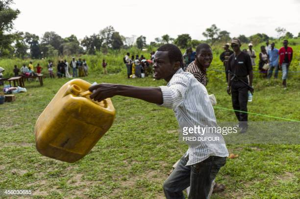 A man complains of insufficient food aid during an aid distribution by the UN World Food Programme near a camp for internally displaced persons in...