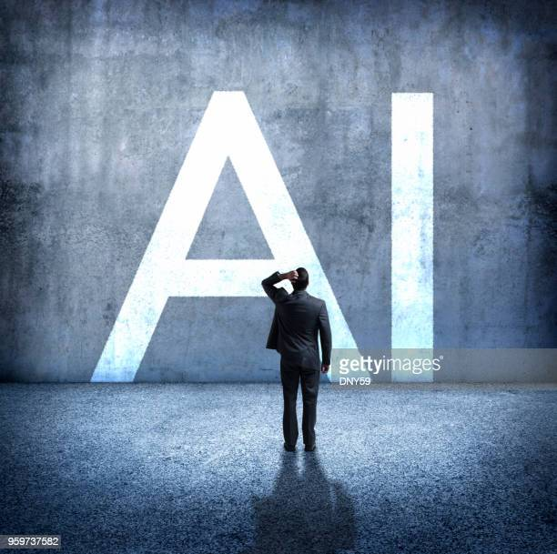 man concerned by implications of artificial intelligence - artificial intelligence stock pictures, royalty-free photos & images