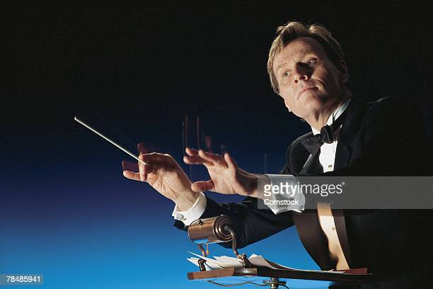 Man conducting symphony