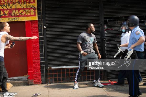 A man confronts police during a protest of the death of George Floyd on May 31 2020 in Philadelphia Pennsylvania Protests have erupted all across the...