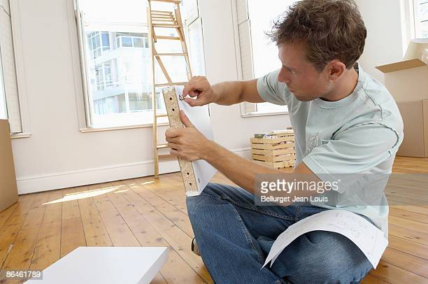 Man constructing shelf