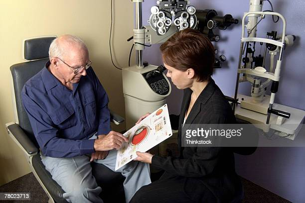 Man consulting with optometrist