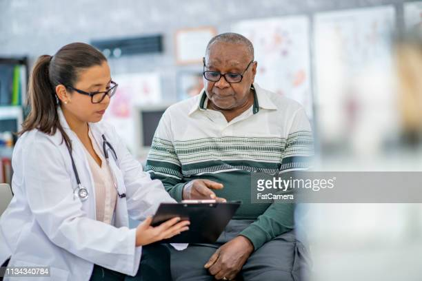 man consults with his doctor - diabetes stock pictures, royalty-free photos & images