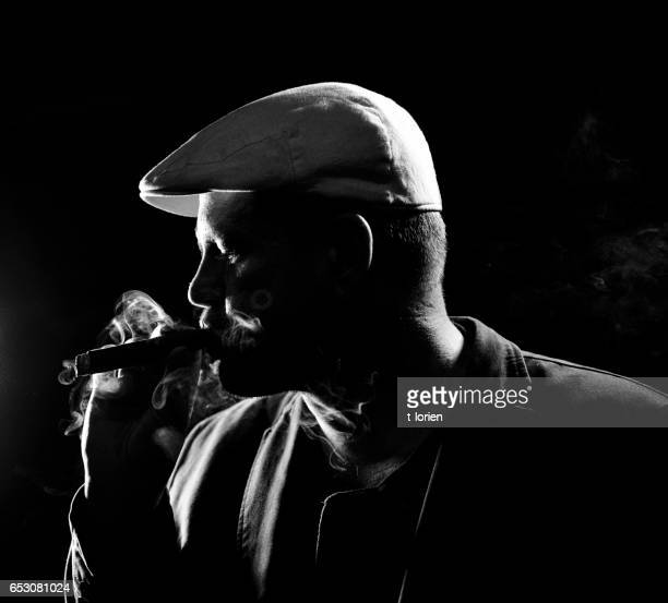 Man contemplating a Cigar
