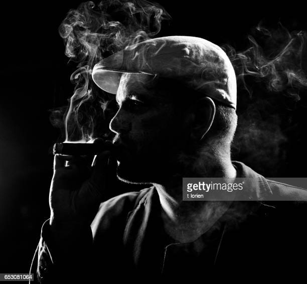 Man contemplating a Cigar