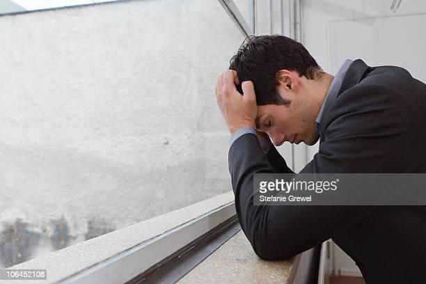 man contemplating after a days work - stefanie grewel stock-fotos und bilder