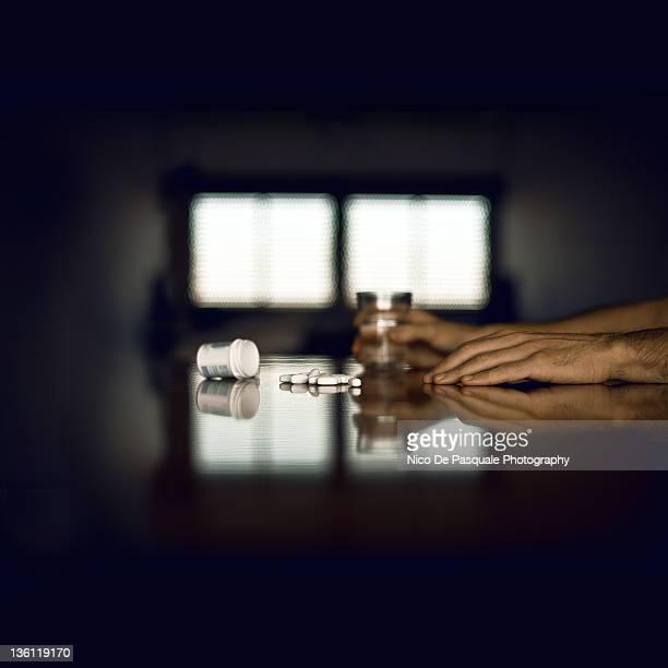 man contemplating suicide - suicidio pastillas fotografías e imágenes de stock