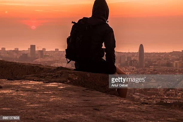 Man contemplating the Barcelona city on sunrise.
