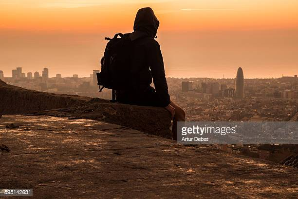 Man contemplating the Barcelona city on sunrise.