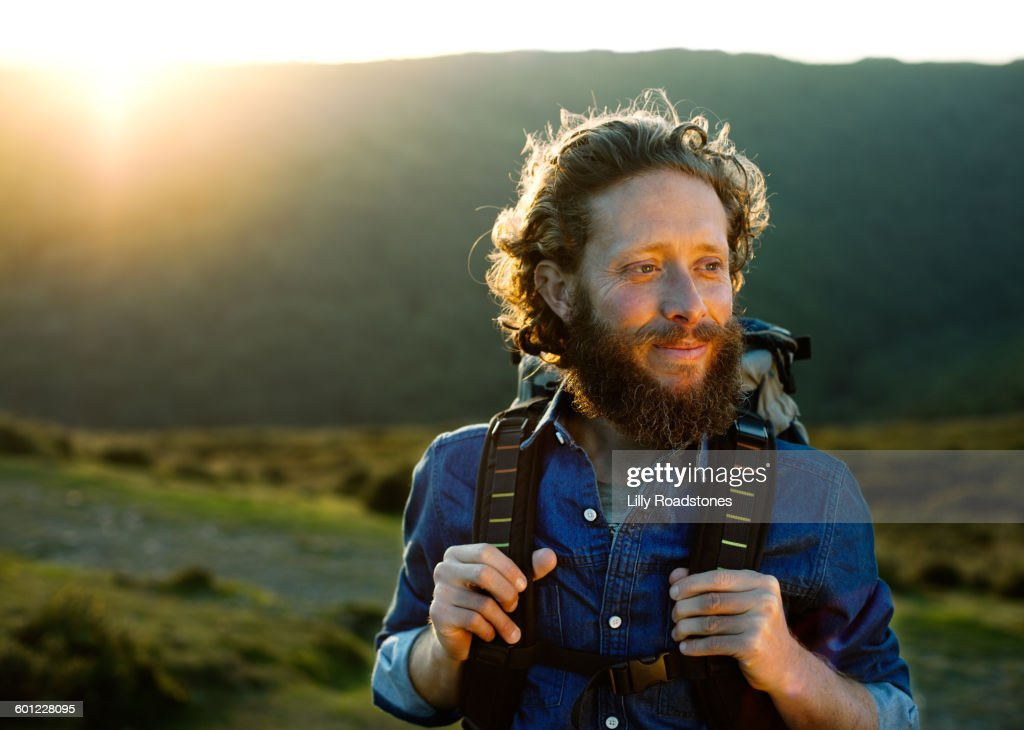 Man contemplating while hiking : Stock Photo