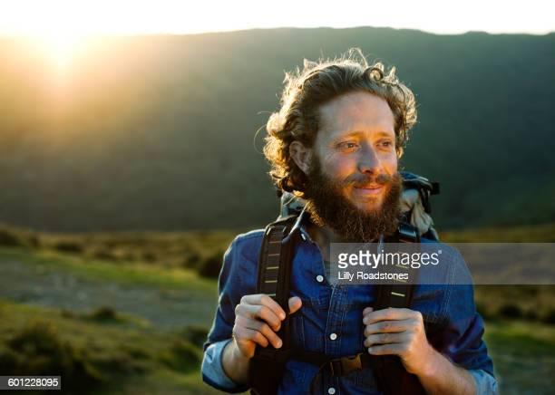 man contemplating while hiking - rucksack stock-fotos und bilder