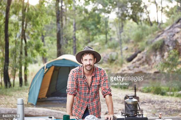 Man cooking and camping in Australian bush