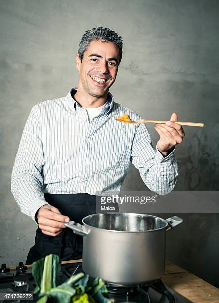 Man cooking  and tasting.