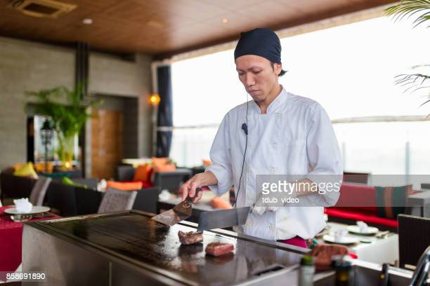 A man cooking at a restaurant