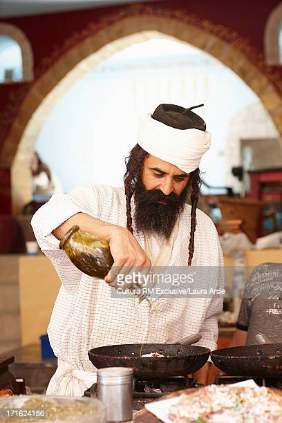 man cooking at food stall in safed, israel - israeli men stock photos and pictures
