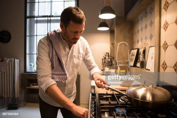 man cooking at home - man on fire stock photos and pictures