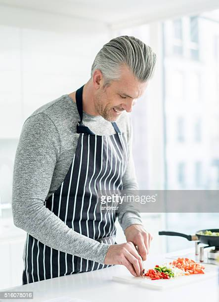 Man cooking dinner at home
