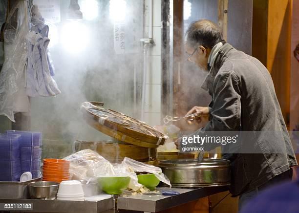 Man cooking dumplings, Kowloon Hong Kong