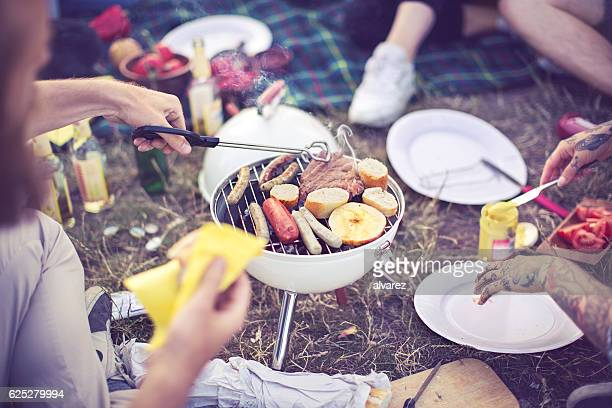Man cooking food over a barbecue