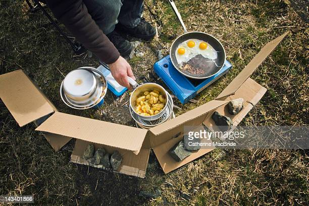man cooking food - catherine macbride stock pictures, royalty-free photos & images