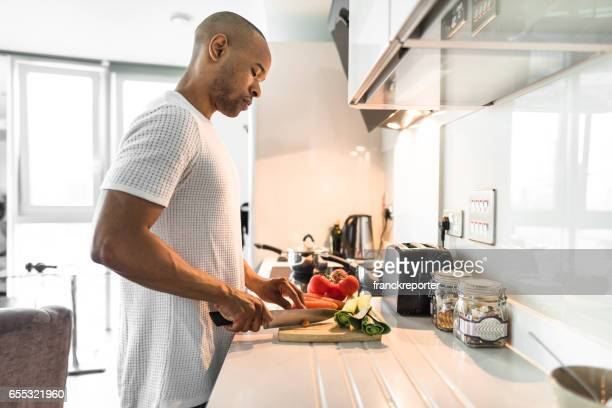 man cooking in a luxury kitchen - selective focus stock pictures, royalty-free photos & images