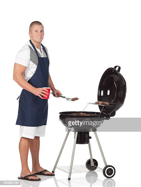 Man cooking on a barbecue grill