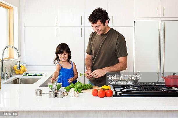 man cooking with daughter - preparing food - fotografias e filmes do acervo