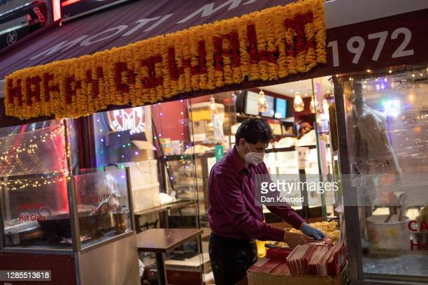 Man cooks traditional sweet snacks on November 13, 2020 in Southall, England. Diwali, the five-day festival of lights, is celebrated by Hindus, Sikhs...