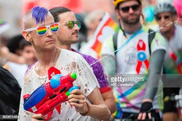 A man cools down spectators with his water gun as he marches in the Pride Parade in Toronto Ontario June 25 2017 The event draws hundreds of...