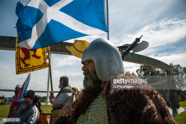 A man cosplays as a soldier from the period of which the Battle of Bannockburn Thousands of Scottish independence supporters marched through Stirling...