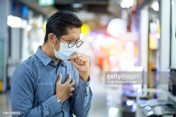 Man coughing and influenza wearing face mask