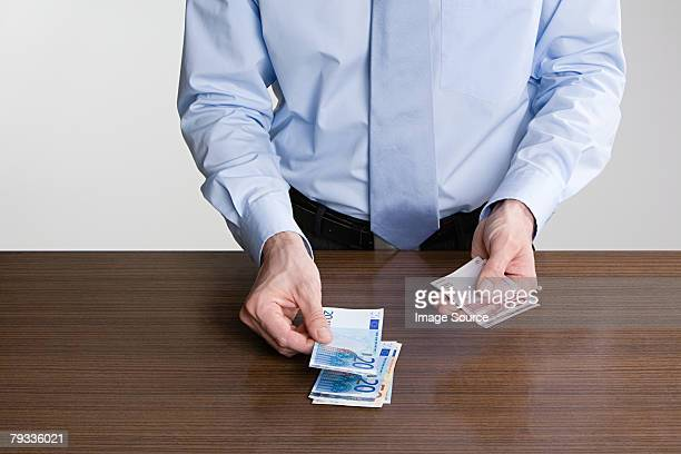 man counting euro notes - twenty euro banknote stock photos and pictures