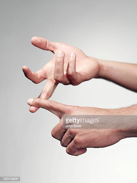 Man counting on fingers, close-up of hands