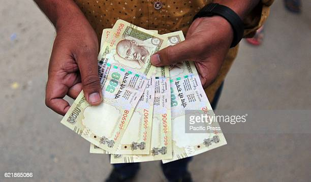 A man counts 500 and 1000 rupee currency note in Allahabad on 09 November 2016 Prime minister Narendra Modi announced demonetization of 500 and 1000...