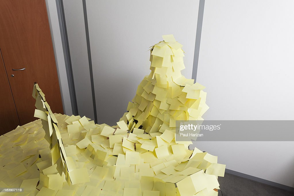 man covered by Post It : Stock Photo