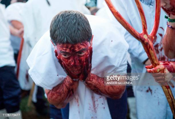 A man covered in cow blood and wearing a Momotxorro costume takes part in the Alsasua carnival in the northern Spanish village of Alsasua in Navarra...