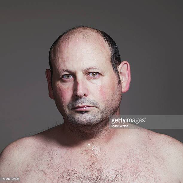 man covered in perspiration - ugly bald man stock photos and pictures