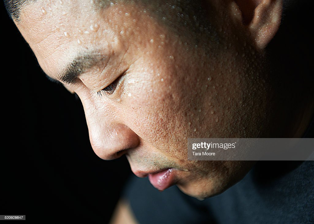 man covered in sweat : Stock Photo