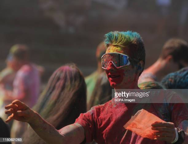 A man covered with coloured powder makes a gesture during a Festival The traditional annual festival of India is gaining popularity in Ukraine At the...