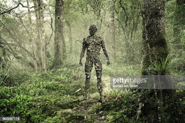 man covered with rocks in forest - disguise stock pictures, royalty-free photos & images