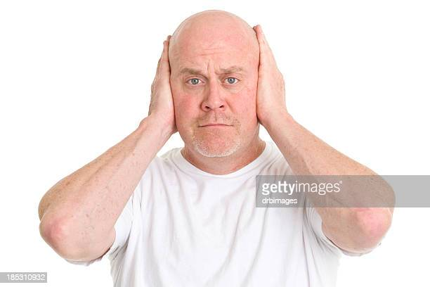 Man Covering Ears