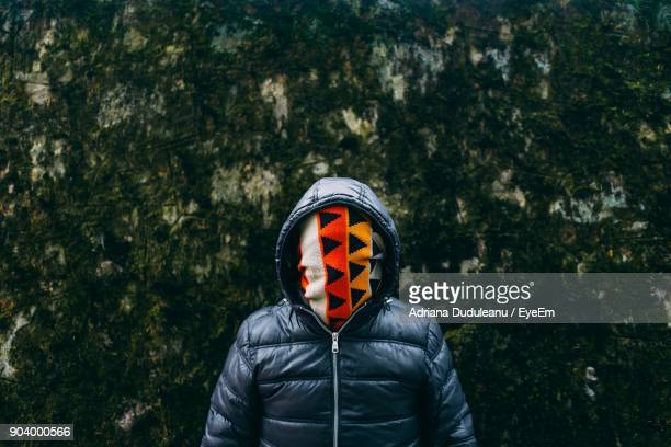 Man Covering Face With Fabric While Standing Outdoors