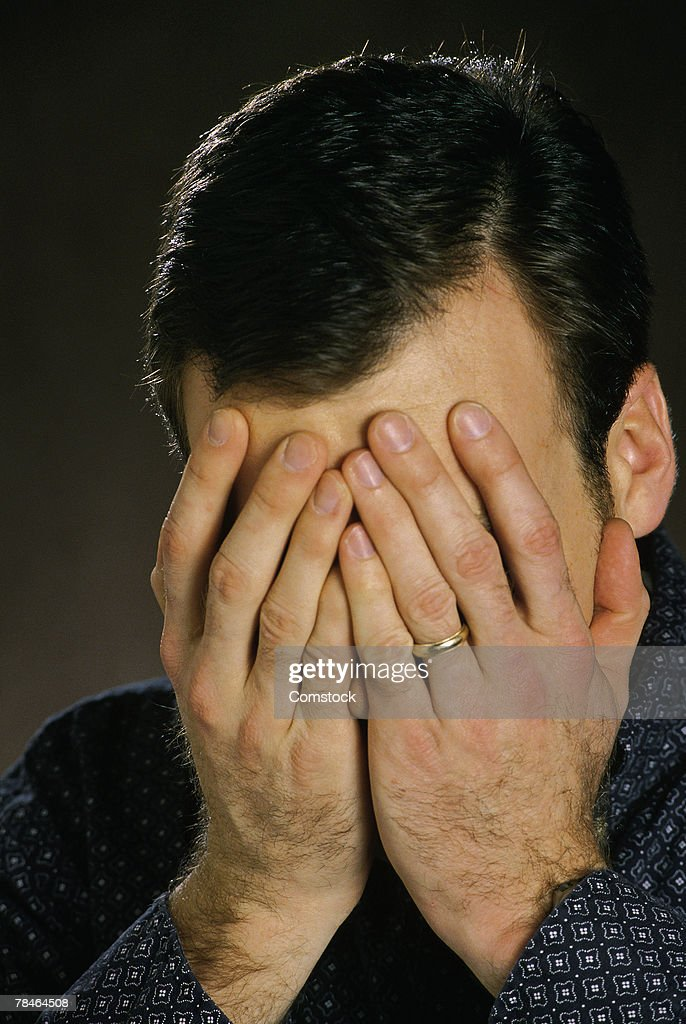 covering face with hands man covering face with hands stock photo getty images 6332